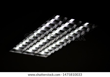 Fluorescent lamps and aluminum tracks on the office ceiling