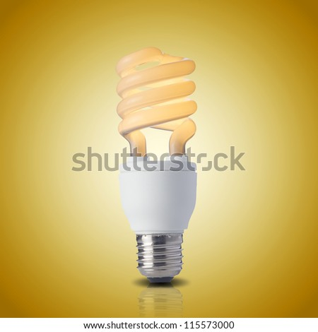 Fluorescent light bulb on yellow background. On light bulb. Concept for energy conservation