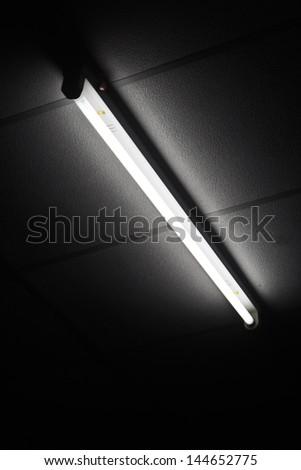 Fluorescent tube on black drop./Fluorescent tube.