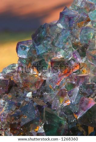 Fluorspar crystal mineral on coloured background
