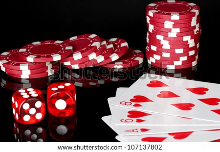 flush with poker chips and dice on black background
