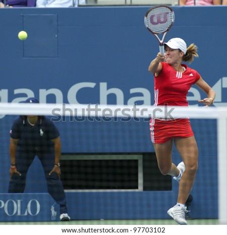 FLUSHING - AUGUST 30: Justine Henin-Hardenne of Belgium hits to Zuzana Ondraskova of the Czech Republic during the U.S. Open at Arthur Ashe Stadium on August 30, 2005 in Flushing Meadows-Corona Park.