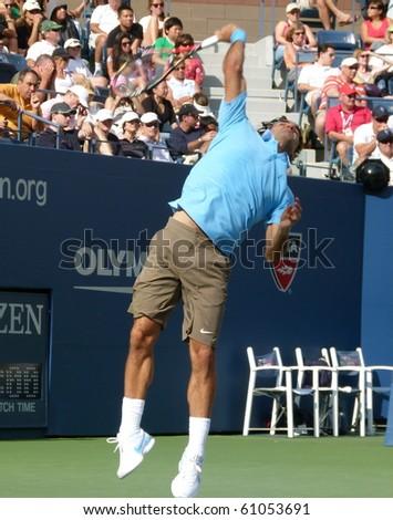 FLUSHING, NEW YORK- SEPT. 4: Roger Federer serves at the US Open, Sept. 4, 2010, Flushing, New York. - stock photo