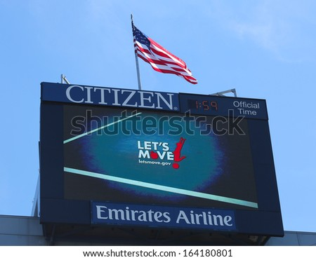 FLUSHING, NY - AUGUST 24: Arthur Ashe Stadium scoreboard promoting Let\'s move program developed by First Lady Michelle Obama to solve the epidemic of childhood obesity on August 24, 2013 in Flushing