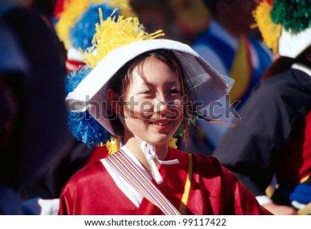 FLUSHING, NY - JANUARY 24: A parade goer celebrates Chinese New Year on January 24, 2001 in Flushing, NY.