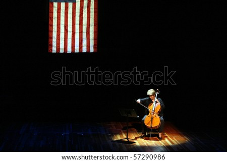 FLUSHING, NY - SEPTEMBER 11:  Cellist Marcy Rosen performs J.S. Bach Suite No. 6 in D. Allemande at Flushing Town Hall on the third anniversary of the 9/11 attacks September 11, 2004 in Flushing, NY.