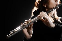 Flute instrument. Flutist hands playing flute music instrument. Closeup of flute player