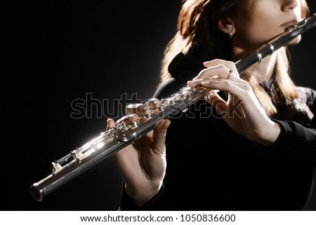 Flute instrument. Flutist hands playing flute music instrument. Closeup of flute player #1050836600