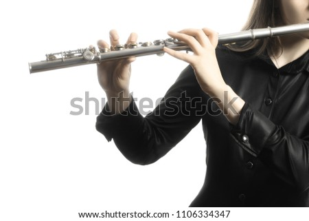 Flute instrument. Flutist playing flute isolated on white. Flute player hands #1106334347