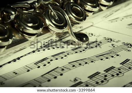 Flute on note background. Classic music concert concept