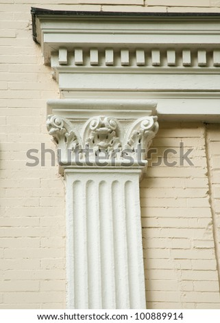 Fluted Corinthian pilaster on the side of an old house.  Beautiful classical architecture.