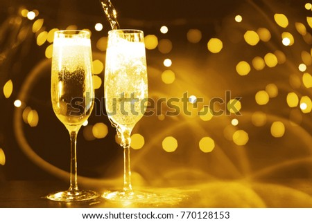 Flutes of champagne in holiday setting  #770128153