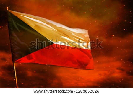Fluttering Czechia flag on crimson red sky with smoke pillars background. Czechia problems concept.