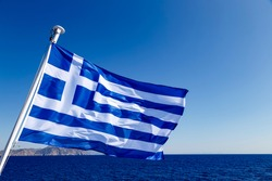 fluttering in the wind Flag of Greece on the ship floats in sea