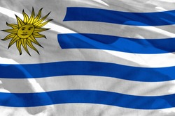 Fluttering Uruguay flag for using as texture or background, the flag is waving on the wind