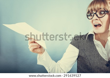Fly fear metaphor, aerophobia concept. Business woman holding airplane in hand.