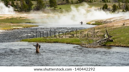 Fly fisherman at Firehole River, Yellowstone National Park