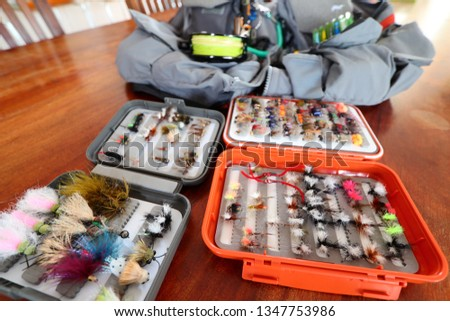 fly fishing flies in tackle box