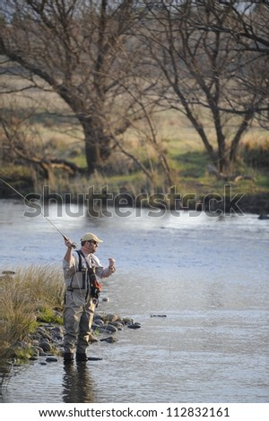 Fly-fishing for rainbow trout on the Umzimkulu river,southern Drakensberg,Kwazulu Natal,South Africa