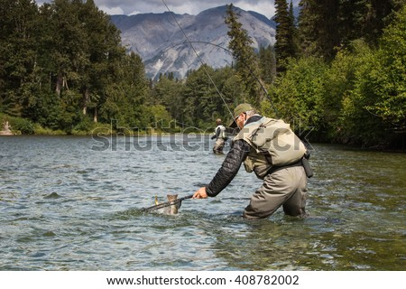 Fly fishing in the pristine wilderness of Canada