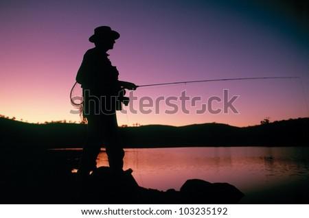 Fly fishing, Lake Jindabyne - stock photo