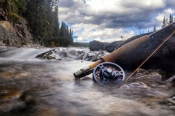 Fly fishing the cold rivers in the Canadian Rocky Mountains for trout is the ultimate adventure