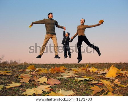 fly happy family with autumn leaves. color sunset sky
