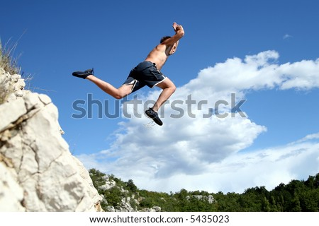 Fly Like An Eagle A young man jumps from a cliff into the sea!