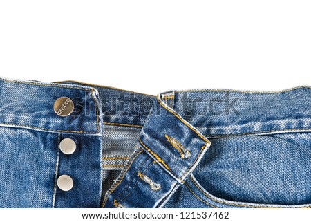 Fly of the blue  jeans with button closure over a white background