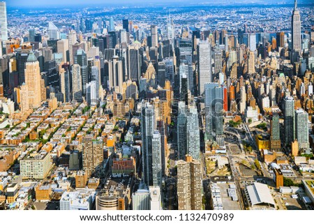 Fly over, view of New York and Midtown Manhattan from a bird's eye view. #1132470989