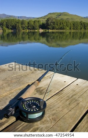 Flyfishing rod and reel with lake and mountians in the background