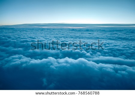 Flying above the clouds. view from the airplane