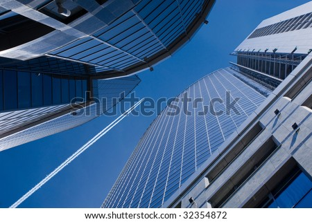 Flying airplane on a background dark blue sky in opening of office buildings