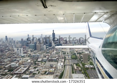 Flying away from Chicago's downtown via airplane