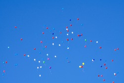 Flying Balloons mid-air objects outdoors play reflexion