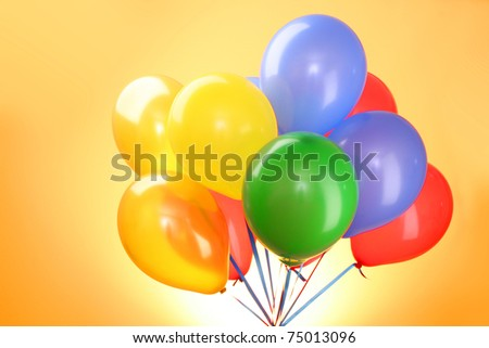 Flying balloons  on a yellow background