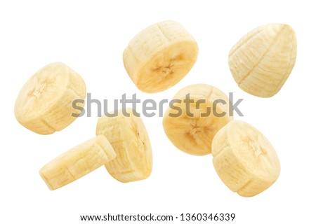Flying banana slices, isolated on white background