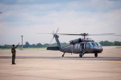 Flying Black Hawk in empty sky