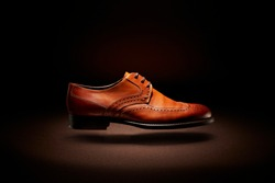 flying brown handmade Italian shoe