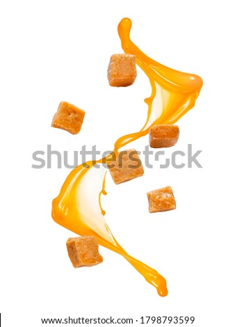 Flying caramel candies with caramel splash Stock photo ©