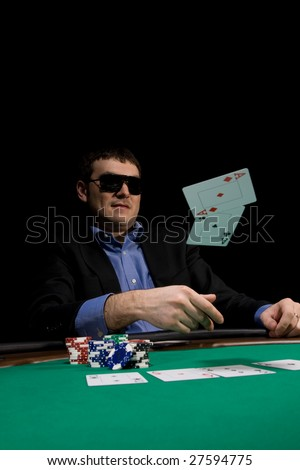 Flying cards in texas hold'em poker over green casino table