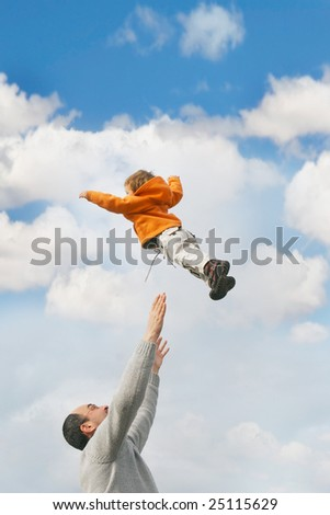 flying child over sky background