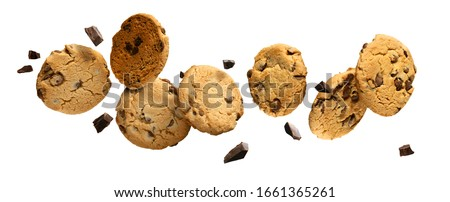 Flying Chocolate chip cookies with pieces of chocolate isolated on white background. High resolution image. Stockfoto ©