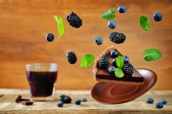 Flying chocolate tart with blackberries and blueberries. toning. selective focus