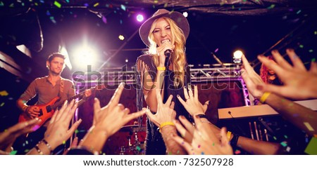Flying colours against singer performing on stage at nightclub #732507928