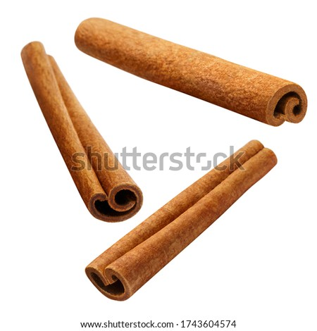 Flying delicious cinnamon sticks, isolated on white background Foto stock ©