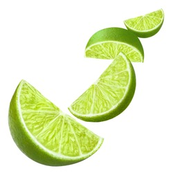 Flying delicious lime slices, isolated on white background