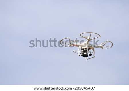 Flying drone in the sky. Flying with an drone for video and photo productions.