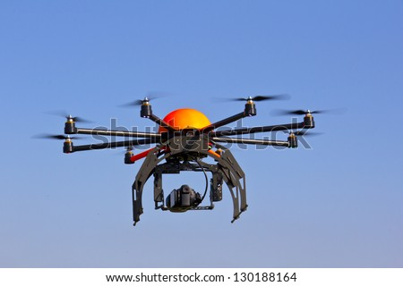 Flying drone in the sky. Flying with an octocopter for video and photo productions