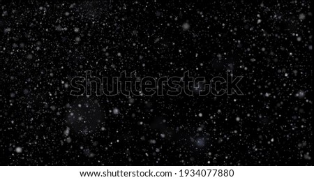 Flying dust particles on a black background Stock fotó ©